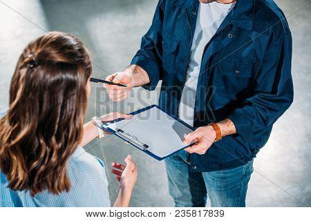 Delivery Man Handling Woman A Cargo Declaration