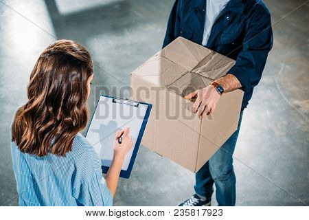 Courier Holding Box While Woman Sighing Cargo Declaration