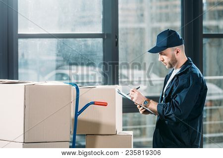 Courier Checking Cardboard Boxes And Cargo Declaration