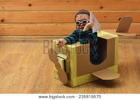 Kid, Pilot School, Innovation. Little Boy Child Play In Cardboard Plane, Childhood. Air Mail Deliver