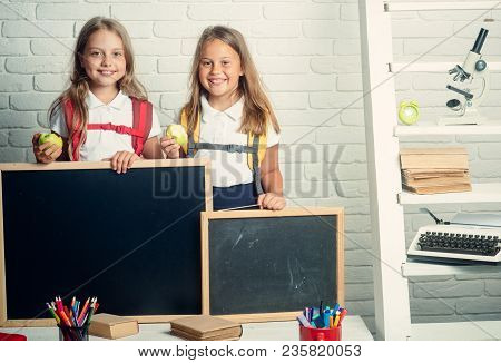 School Time Of Girls. School Time Of Kids With Blackboard For Copy Space