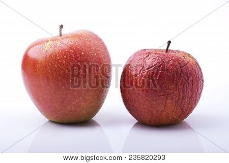 Conceptual Metaphor.the Passing Time Represented By Two Apples, One Fresh, Healthy And Beautiful The