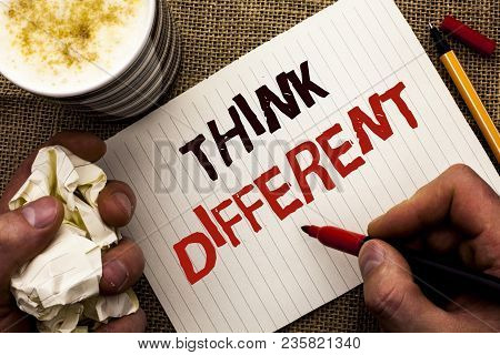 Writing note showing  Think Different. Business photo showcasing Rethink Change on vision Acquire New Ideas Innovate written by Man Holding Marker Notebook Book the jute background poster