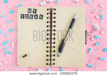 My Ideas List. In The Center Of The Mess From The Stationery Is A Notebook With Pages Of Brown Color