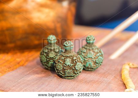 Small, Decorative, Green And Brown Vases On A Table. Asian Style Decor.