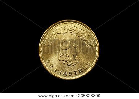 A Macro Image Of A Fifty Piastre Coin From Egypt Isolated On A Black Background