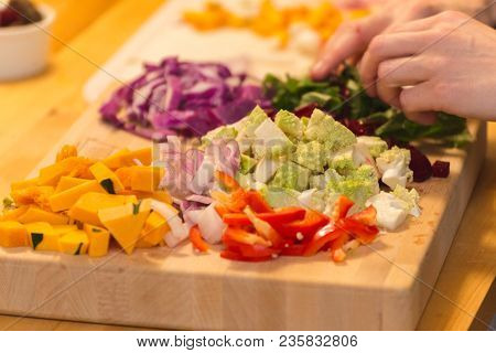 Various Bright And Colorful Vegetables On Wood Cutting Board, Being Prepared For A Meal. Vegetables