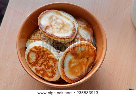 Fragrant Pancakes In A Plate, Round Small Pancakes In A Deep Plate, Pancakes In A Deep Bowl