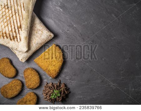 Snack Composition With French Tacos, Cordon Bleu, Nuggets And Beef On Slate