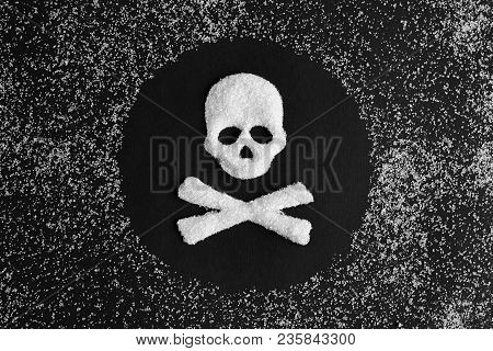 Skull And Bones Made From Sugar And A Scattering Of Granulated Sugar On A Black Background. Concept