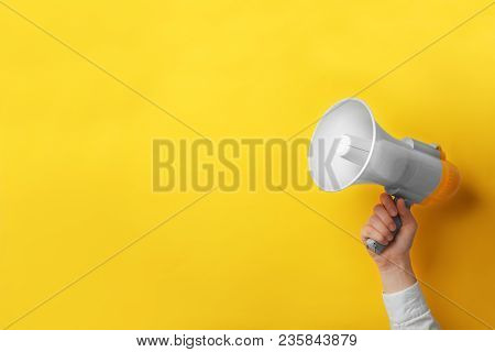 Man Holding Megaphone On The Color Background