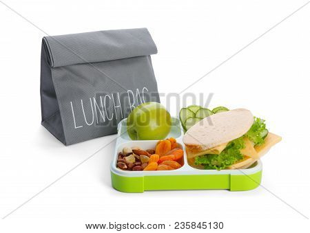 Lunch Box With Appetizing Food And Bag On White Background