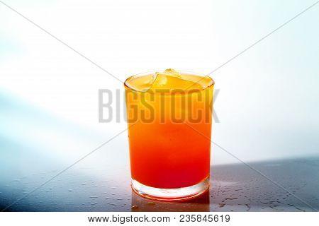 Orange Juice As Background / Orange Juice Is The Liquid Extract Of The Fruit Of The Orange Tree, Pro