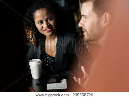 Partners discussing business over coffee