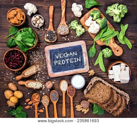 Vegan protein sources. Top view on a brown wooden background