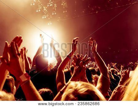 concert crowd in front of bright stage lights