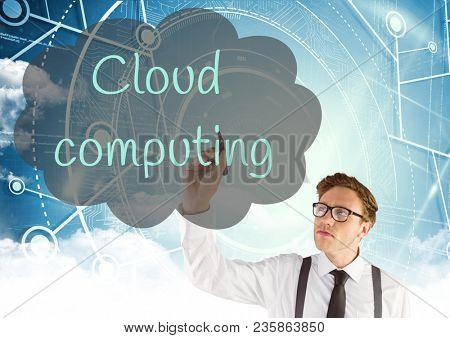 Young man writing in the screen CLOUD COMPUTING inside a cloud. Computing background