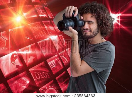 Photographer taking a picture in front of a photo montage frame