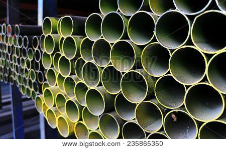 Round Steel Pipes On Shelf Ready For Sales In The Steel Shop