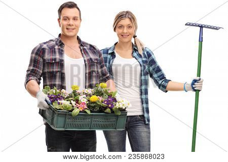 Male gardener with a rack of flowers and a female gardener with a rake isolated on white background