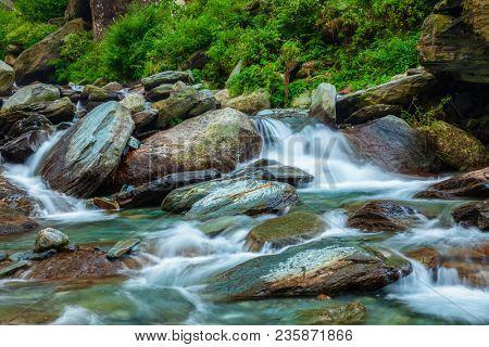 Cascade of Bhagsu (Bhagsunag, Bagsu) waterfall. Bhagsu (Bagsu), Himachal Pradesh, India. Polarizer filter used
