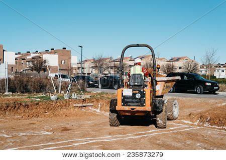 Guadalajara, Spain - January 22, 2018: Earth Mover Machinery On Construction Site