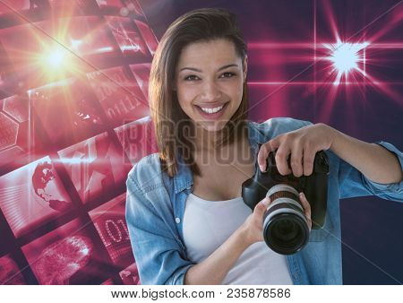 Photographer holding a camera against disco ball
