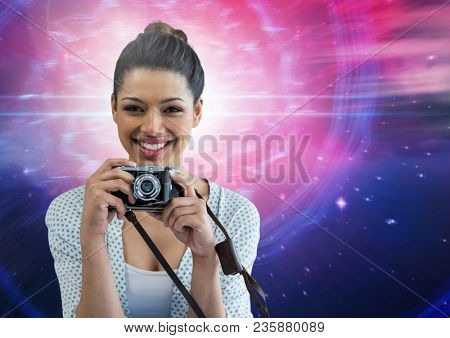 Photographer holding a camera against galaxy background