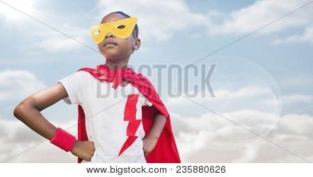 Superhero girl against sky with flare