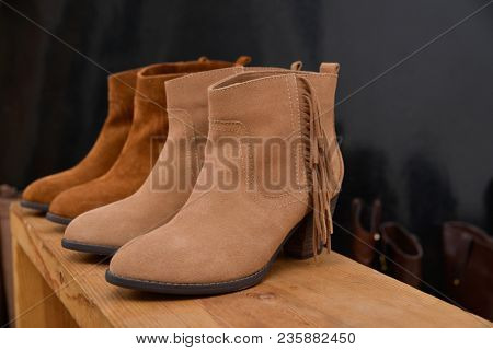 Boots Shoe shop – leather boots collection on wooden cube shelves