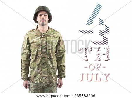 Proud soldier standing against 4th of July background