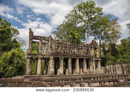 Ancient Two-storied Building With Round Columns Of Preah Khan The Stone Temple Surround With Forest
