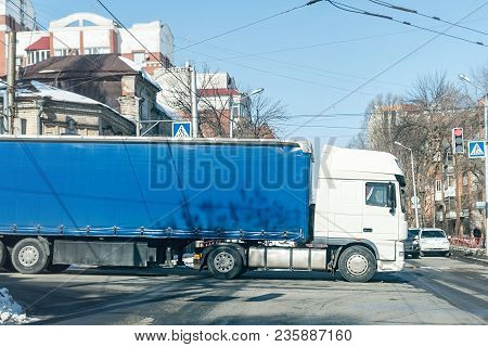 Big Truck At The Crossroads In The City