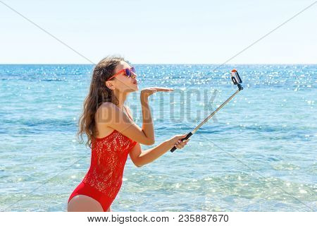 Young Girl Having Fun Taking Smartphone Selfie Pictures Of Herself. Travel Holidays.