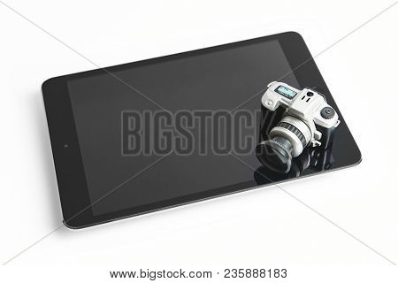 Tablet And Photographic Camera Thumbnail Isolated On White. Photo Equipment
