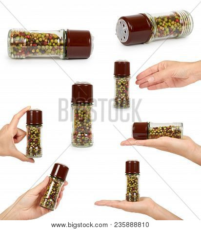 Set Of Different Glass Pepper Mill With Hand. Isolated On White Background, Hot And Spicy Flavor.