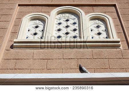 Pigeon Standing On  An Orthodox Church Window.