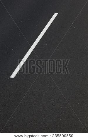 Asphalt Road With A White Mark Line.