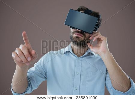 Man in virtual reality headset against brown background