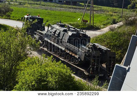 Transport Of Military Armored Tank On Road.