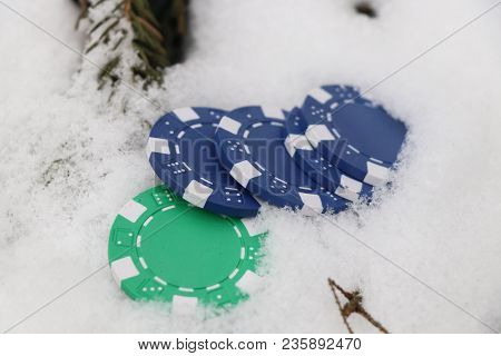 A Few Jettons Chuck To Snow. Green And Blue Can Be Used For Roulette