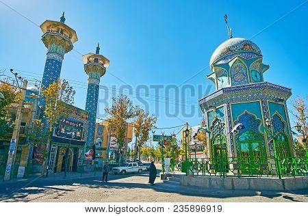 Rayen, Iran - October 16, 2017: The Beautiful Tiled Shrine Of Iran-iraq War Martyr With A Clock Towe