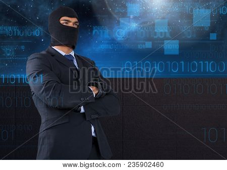 Business hacker with arms crossed in front of blue night sky