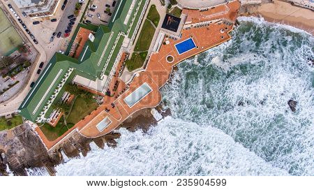 Aerial. Waves During A Storm Wash The Shore Ericeira Portugal.