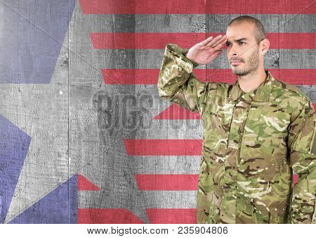 Proud soldier saluting against american flag background