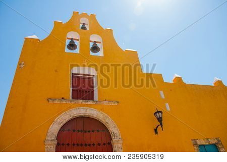 The Temple With Bells. Yellow Church And Colonial Architecture In San Francisco De Campeche., Mexico