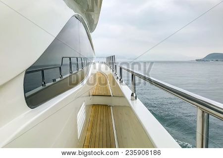 Wooden Aloft And Glass With Reflection In White Luxury Yacht