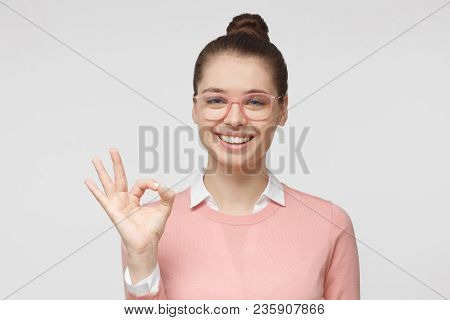 Young Woman Having Happy Look, Smiling, Gesturing, Showing Ok Sign. Caucasian Female Showing Ok-gest