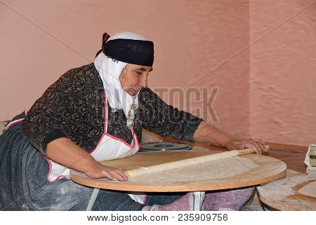 Konya, Turkey - November 10, 2009: A Eldery Turkish Woman Preparing Traditional Turkish Unleavened B