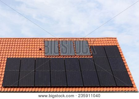 House With Solar Panels On A Roof